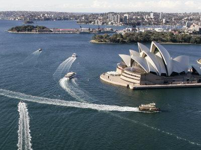https://imgc.allpostersimages.com/img/posters/ferries-pass-the-sydney-opera-house_u-L-Q10OS7X0.jpg?p=0