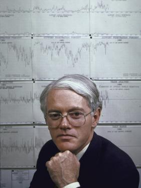 Fidelity Magellan Fund Manager Peter Lynch in Front of Graph of American Stock Prices