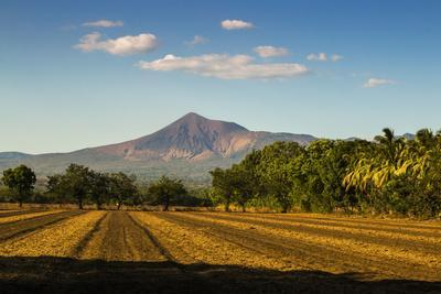 https://imgc.allpostersimages.com/img/posters/fields-north-of-leon-and-volcan-telica_u-L-PWFHAT0.jpg?p=0