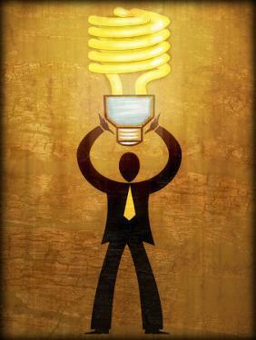 Figure Holding Energy-Efficient Light Bulb