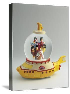 Figurines of the Beatles Band in a Snow Globe