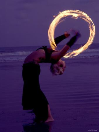 Fire-eater Twirling Fire on the Beach, Samara Beach, Guanacaste, Costa Rica