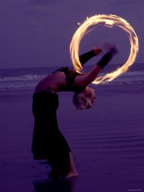 Fire-eater Twirling Fire on the Beach, Samara Beach, Guanacaste, Costa Rica