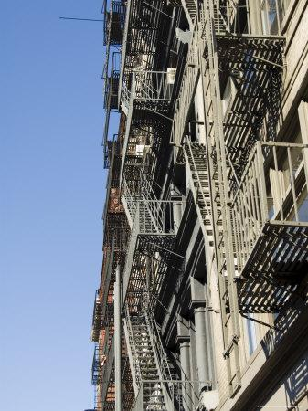 https://imgc.allpostersimages.com/img/posters/fire-escapes-on-the-outside-of-buildings-in-spring-street-soho-manhattan-new-york-usa_u-L-P2QYKK0.jpg?p=0