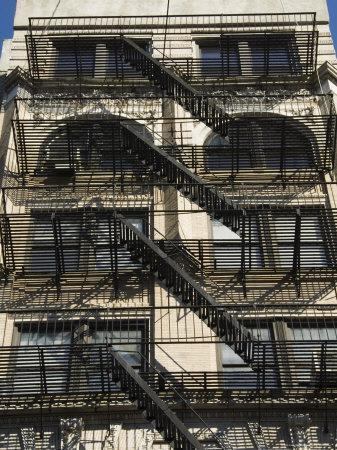 https://imgc.allpostersimages.com/img/posters/fire-escapes-on-the-outside-of-buildings-in-spring-street-soho-manhattan-new-york-usa_u-L-P2QYMQ0.jpg?artPerspective=n
