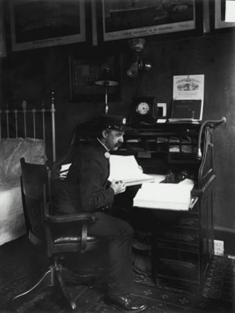 Fireman Looking Over Papers in Station House