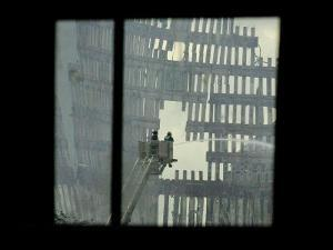 Firemen are Seen Spraying Water on the Smoldering Ruins of the World Trade Center
