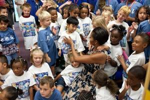 First Lady Michelle Obama Greets Children at Naval Air Station Oceana Summer Camp