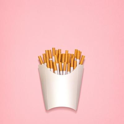 Conceptual Still Life of Cigarettes, Packed as Fried Potatoes in a Paper Box
