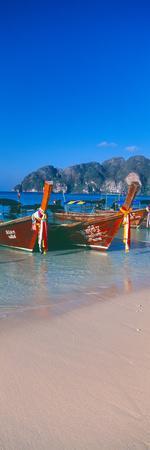 https://imgc.allpostersimages.com/img/posters/fishing-boats-in-the-sea-phi-phi-islands-phuket-province-thailand_u-L-PSNR0U0.jpg?p=0