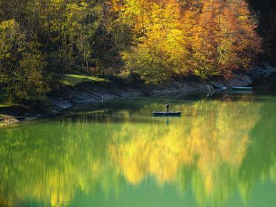 https://imgc.allpostersimages.com/img/posters/fishing-on-lake-sylvanstein-germany-with-fall-colors_u-L-PU3F2X0.jpg?p=0