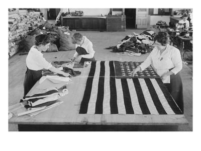 https://imgc.allpostersimages.com/img/posters/flags-laid-out-on-cutting-table-to-be-sewn-by-seamstresses-during-the-period-of-the-great-war_u-L-PGFA8Y0.jpg?p=0