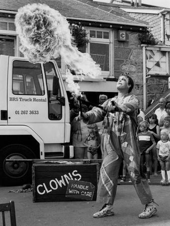 https://imgc.allpostersimages.com/img/posters/flame-throwing-clown_u-L-Q1075XF0.jpg?p=0