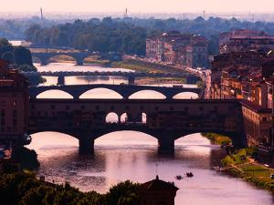 Florence, Florence Province, Tuscany, Italy. View to bridges across Arno river. Ponte Vecchio in...