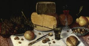 An Uitgestald Still Life of Grapes and Cheese on Pewter Plates� by Floris van Dijck
