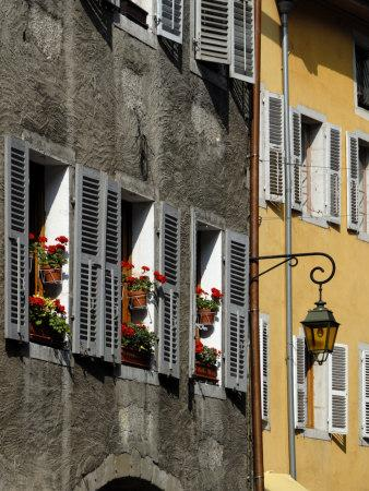 https://imgc.allpostersimages.com/img/posters/flower-bedecked-shuttered-windows-rue-sainte-claire-annecy-rhone-alpes-france-europe_u-L-P7WZV80.jpg?p=0
