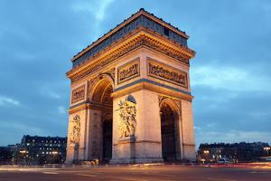 Arc De Triomphe in Paris, France at Night by Flynt
