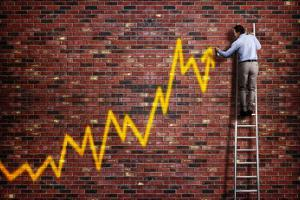 Businessman Standing on a Ladder and Drawing a Graph with Positive Trend in Graffiti Style Yellow S by Flynt