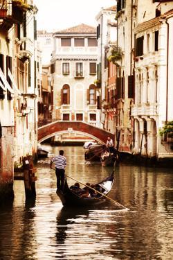 Gondola Traveling down the Canals of Venice in Italy by Flynt