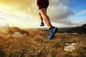 Outdoor Cross-Country Running in Early Sunrise Concept for Exercising, Fitness and Healthy Lifestyl by Flynt