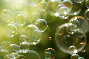 Soap Bubbles Floating in the Air as the Summer Sun Sets by Flynt