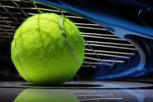 Tennis Racquet Resting on Top of a Tennis Ball by Flynt