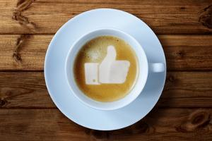 Thumbs Up or Like Symbol in Coffee Froth by Flynt