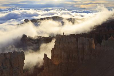 https://imgc.allpostersimages.com/img/posters/fog-and-clouds-of-a-partial-temperature-inversion-surround-the-red-rocks-of-bryce-canyon_u-L-PQ8PTB0.jpg?p=0