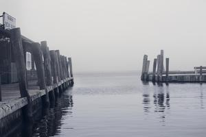Foggy view of the docks at the ferry at Ocean Beach Fire Island NY