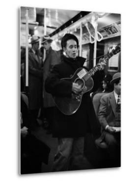 Folk Singer Woody Guthrie Singing Aboard a Subway Train