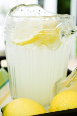 Lemonade in a Glass Jug with Slices of Lemon by Foodcollection