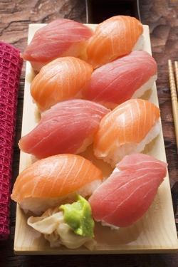 Nigiri Sushi with Tuna and Salmon on Sushi Board by Foodcollection