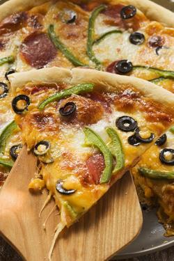 Pizza with Cheese, Salami, Peppers, Olives; Piece on Server by Foodcollection