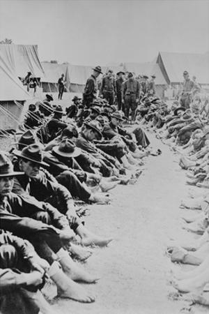 Foot Inspection, Soldiers Sit on Ground While Doctors Prepare to Examine a Full Unit at Once