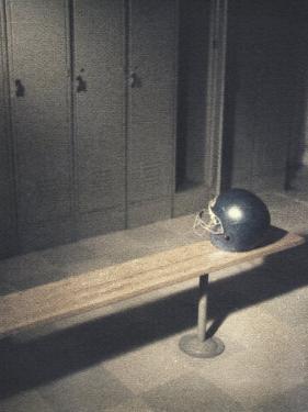Football Helmet on Bench in Locker Room