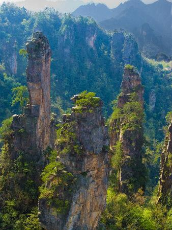 https://imgc.allpostersimages.com/img/posters/forested-sandstone-pinnacles-zhangjiajie-national-forest-park-hunnan-china_u-L-PXQ2P20.jpg?p=0