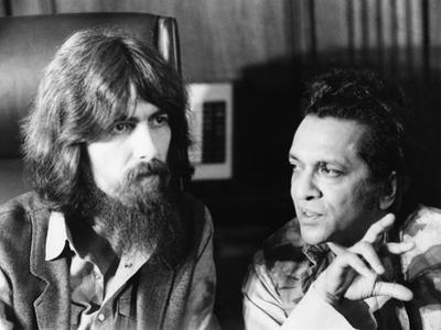 Former Beatle George Harrison (Left) and Indian Musician Ravi Shankar Talk to Newsmen in New York