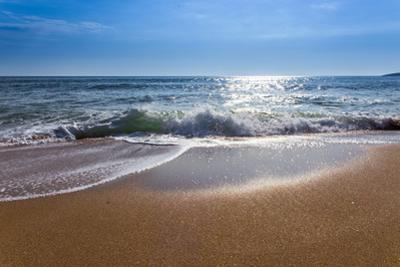 Sand Sea Beach and Blue Sky after Sunrise and Splash of Seawater with Sea Foam and Waves by fototo