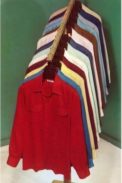 Colored Shirts on Rack by Found Image Press