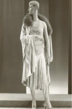 Twenties Female Mannequin Wearing Evening Gown and Fur Collar by Found Image Press