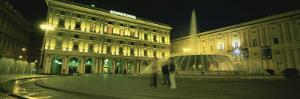 Fountain in Front of Buildings Lit Up at Night, Piazza de Ferrari, Genoa, Italy