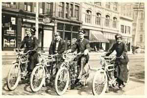 Four Bicyclists Downtown