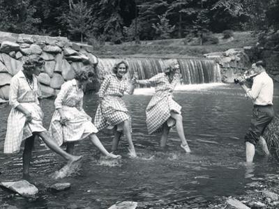Four Models Kicking Water, 1958