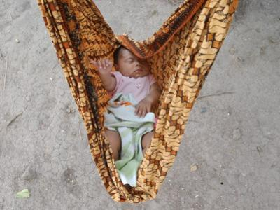 Four-Month-Old Rianto Sleeps in a Batik Cloth Swing, at a Refugee Camp in Lamreh, Indonesia