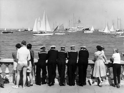 Watching Cowes by Fox Photos