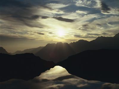 https://imgc.allpostersimages.com/img/posters/france-lac-noir-l-alpe-d-huez-evening-sun_u-L-Q11YF810.jpg?p=0