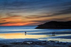 Beach Goers Enjoy the Last Rays of Sunlight at White Sands Beach in St. Davids, Wales by Frances Gallogly