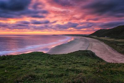 Colorful Sunset over the Beach in Rhossili on the Gower Peninsula, Wales, United Kingdom