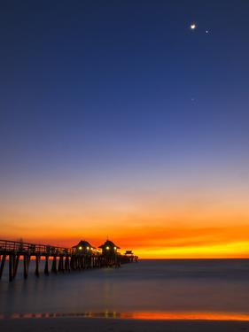 Naples Pier at Sunset with Crescent Moon, Jupiter and Venus by Frances Gallogly