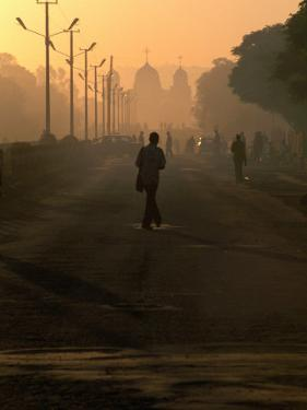 People on Their Way to Work, with St. Gabriel's Church in Background, Awasa, Ethiopia by Frances Linzee Gordon